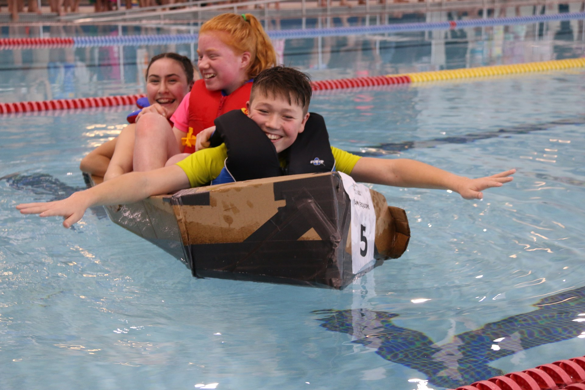 St. Michael team in their cardboard boat