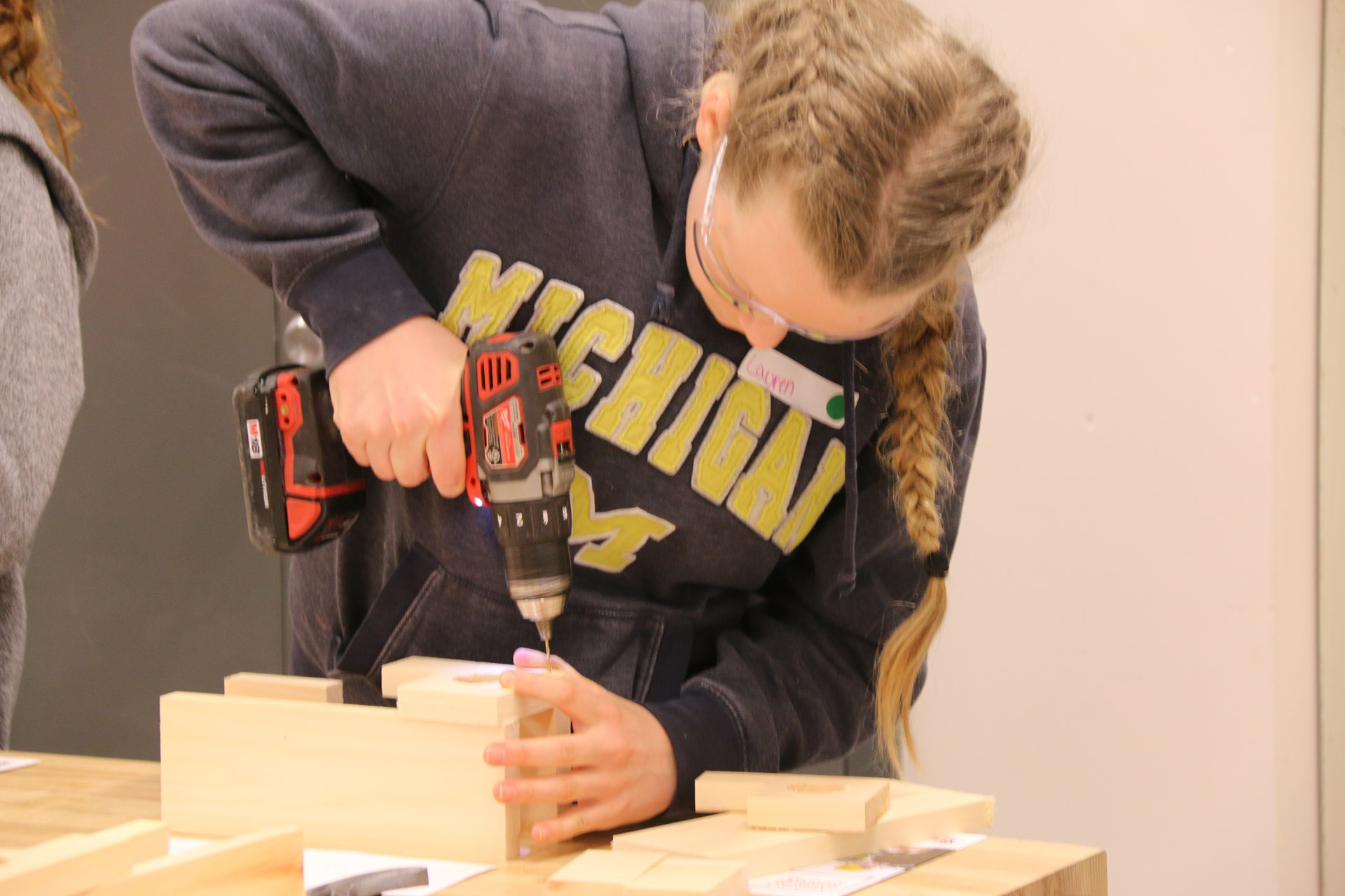 Student working at hands on activity with a drill