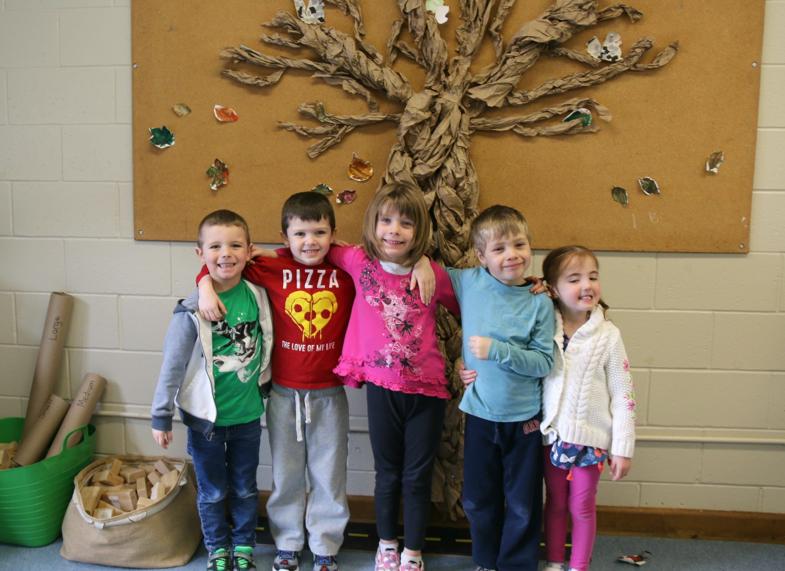 Five kindergarten students standing together