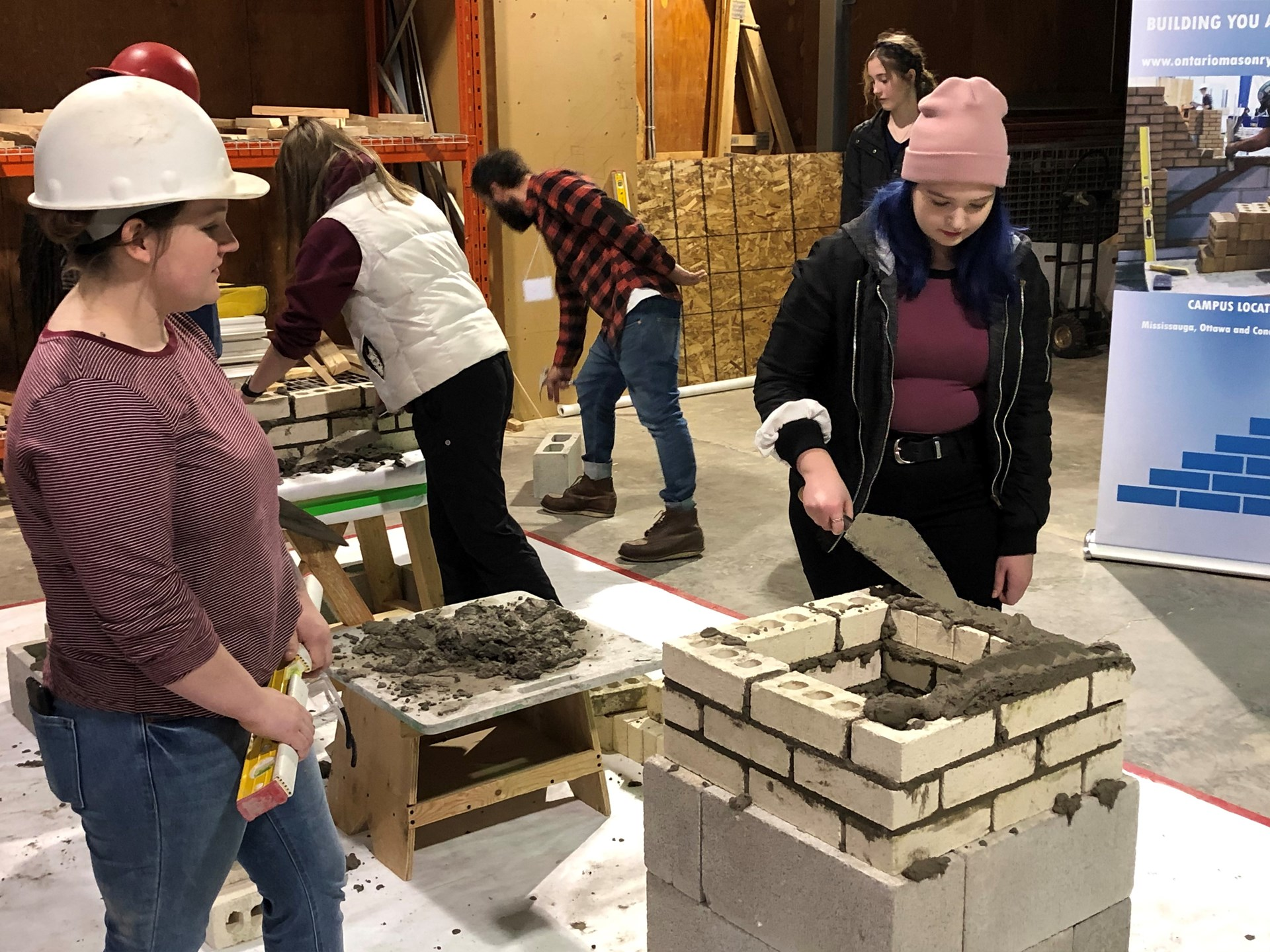 student at the masonry station
