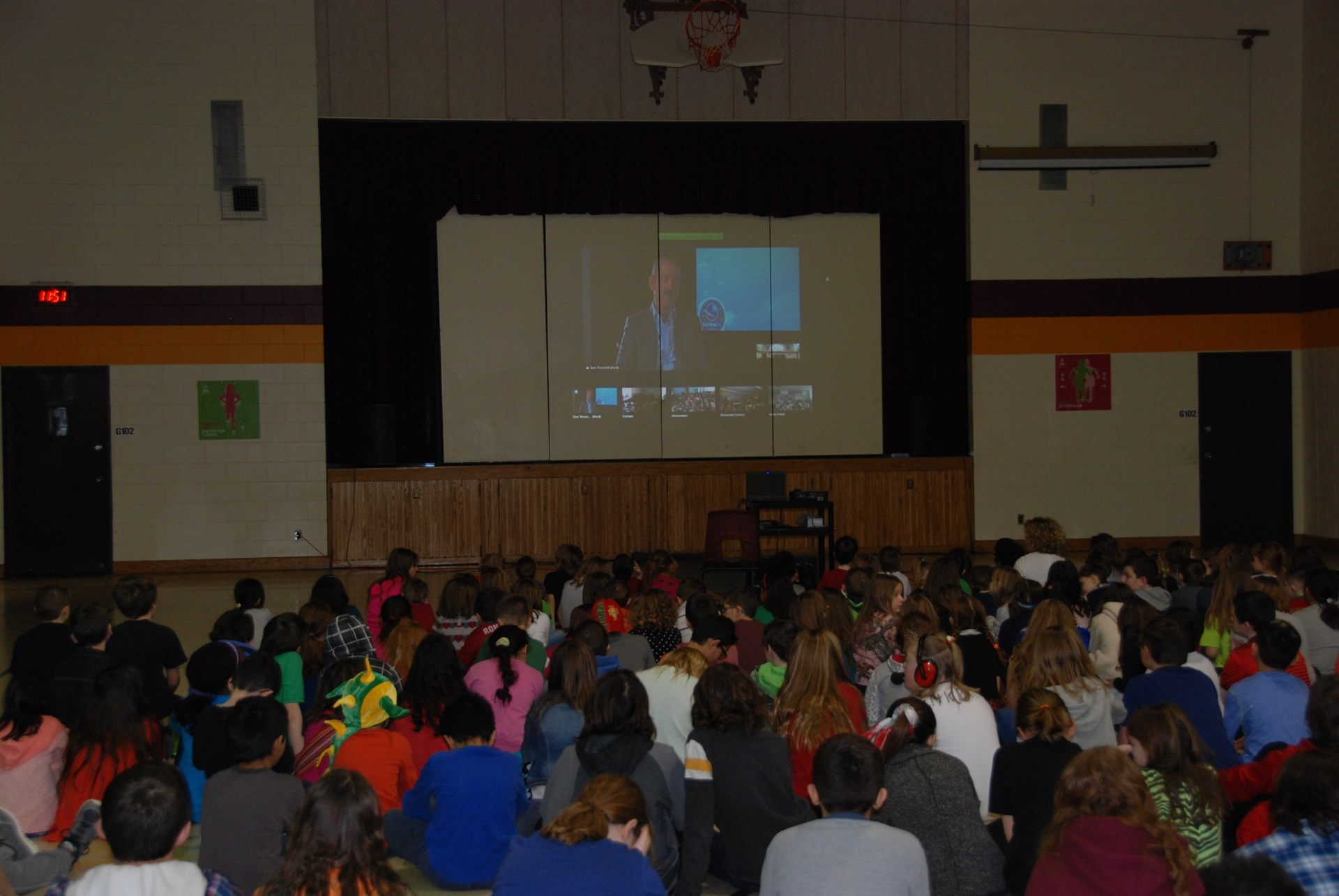Students watching webinar with Chris Hadfield