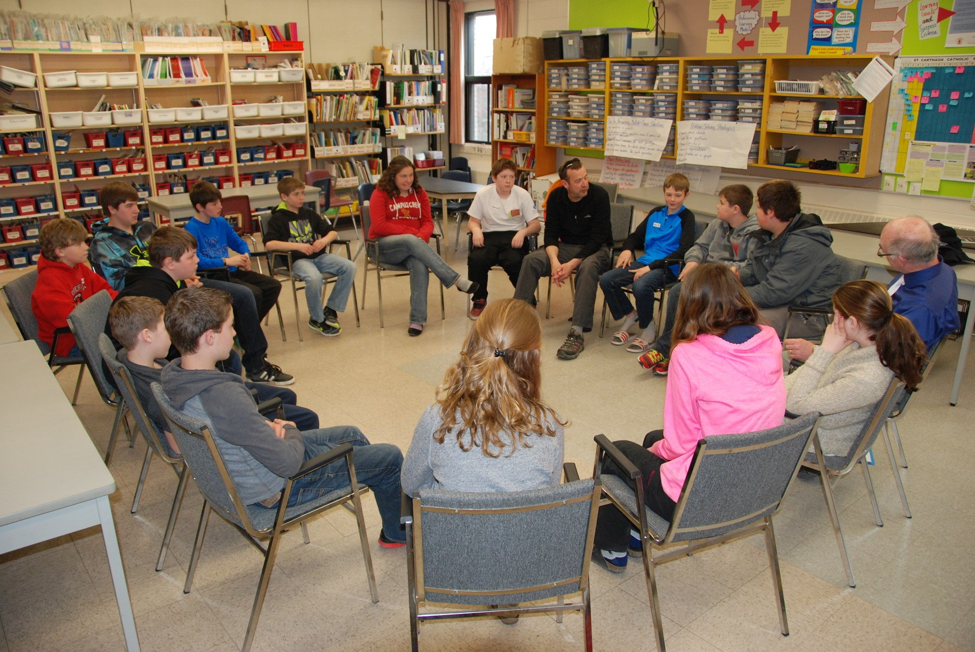 Students in circle for restorative practice