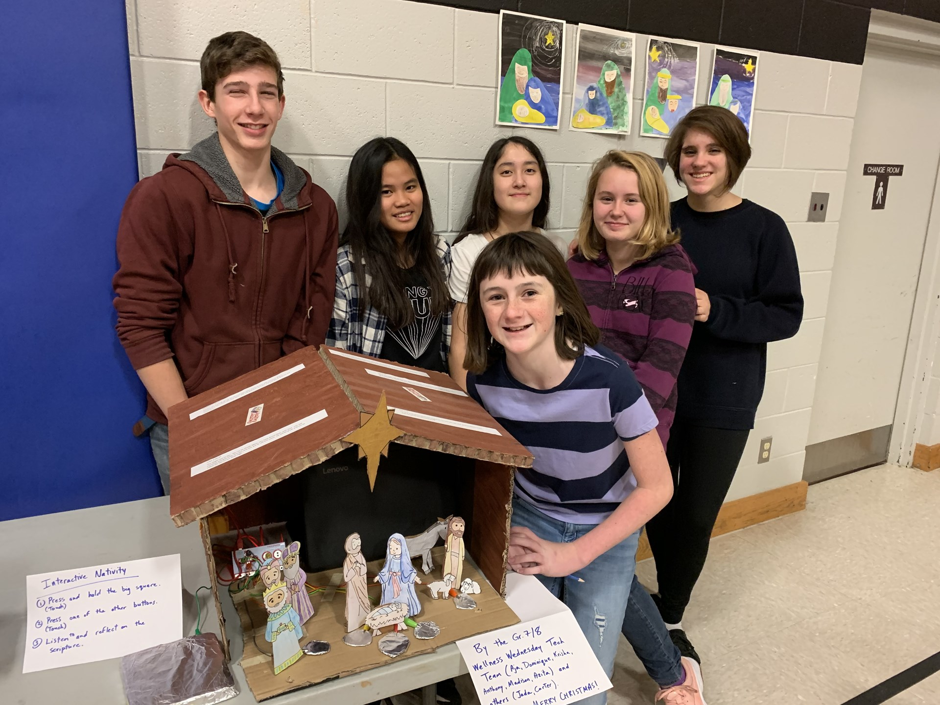 Students in front of their interactive Nativity scene.