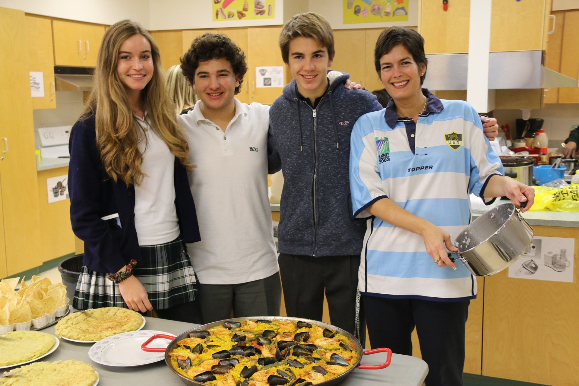 Students cooking with teacher