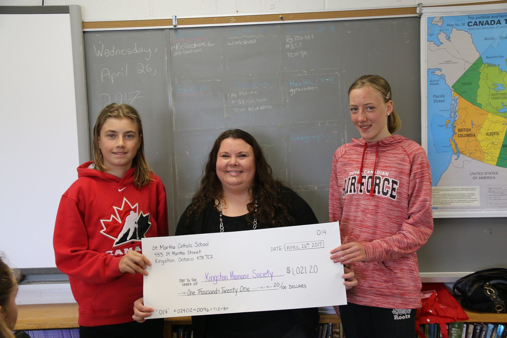 Students presenting cheque to Humane society employee