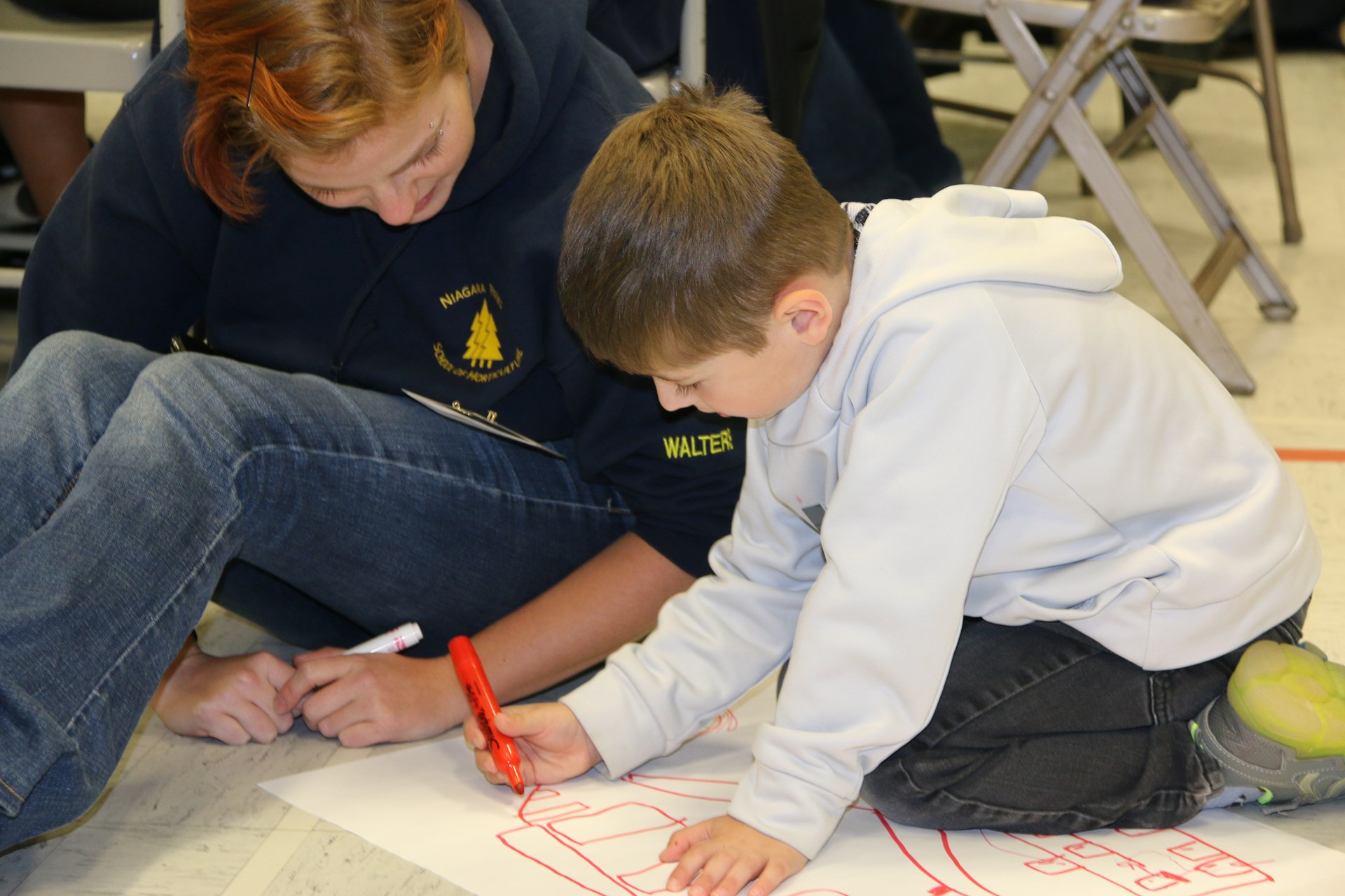 students drawing together