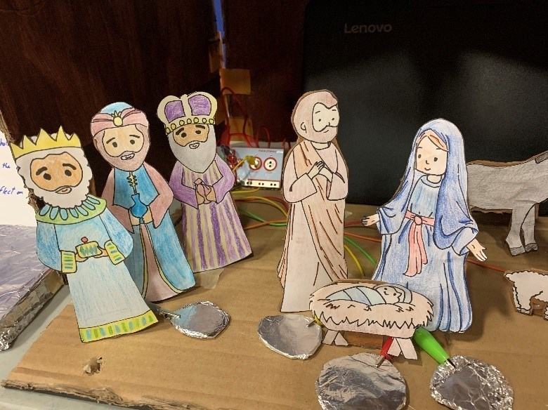Mary and Joseph with the three Wise Men.