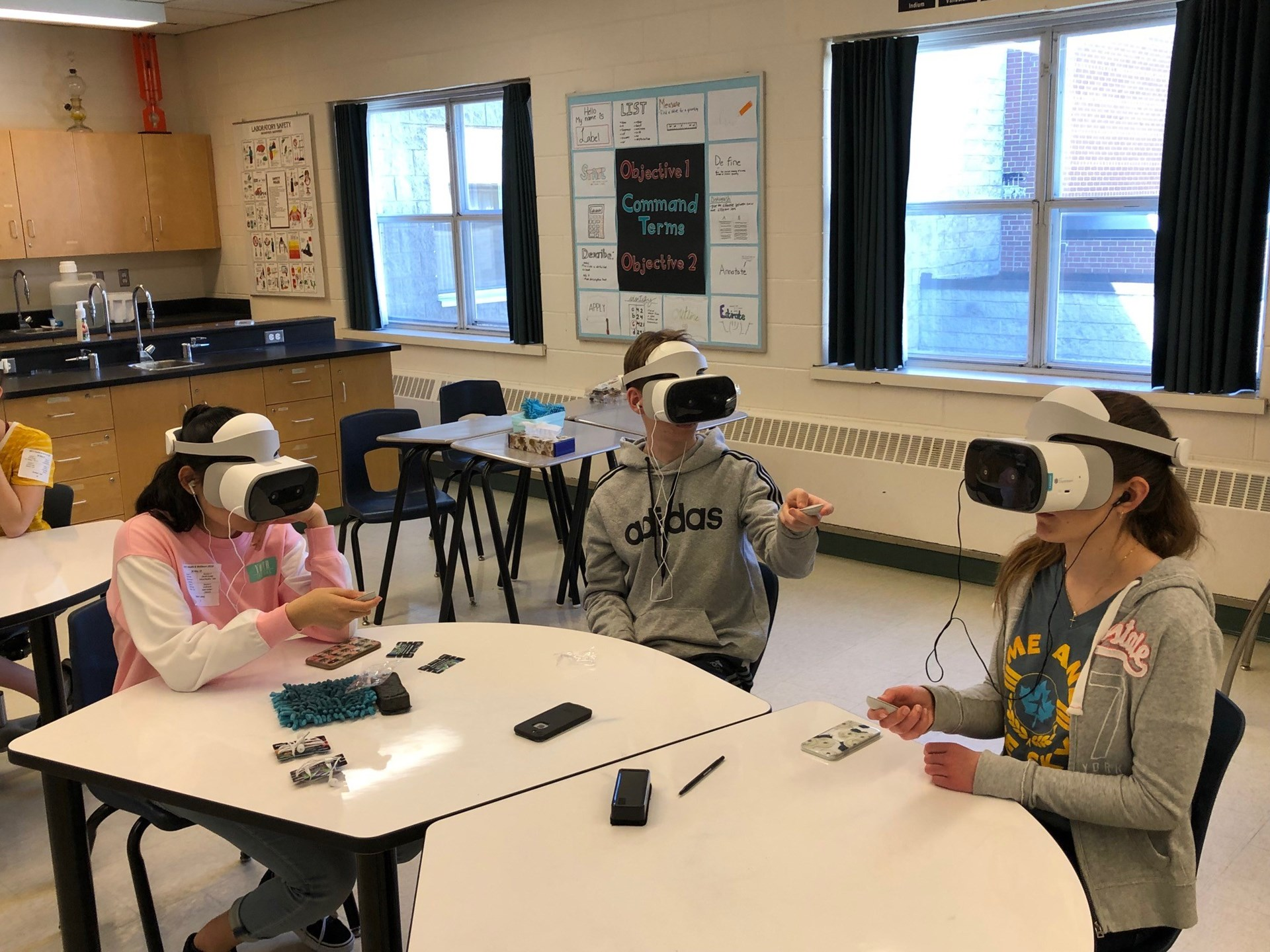 students playing with the virual reality technology