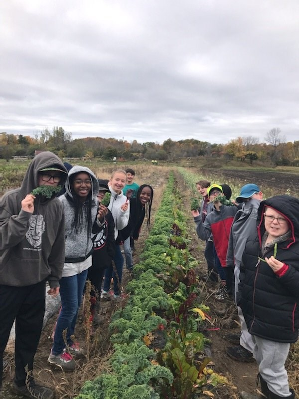 Students learning on-site at our Community Garden supported by the Loving Spoonful Grow Project