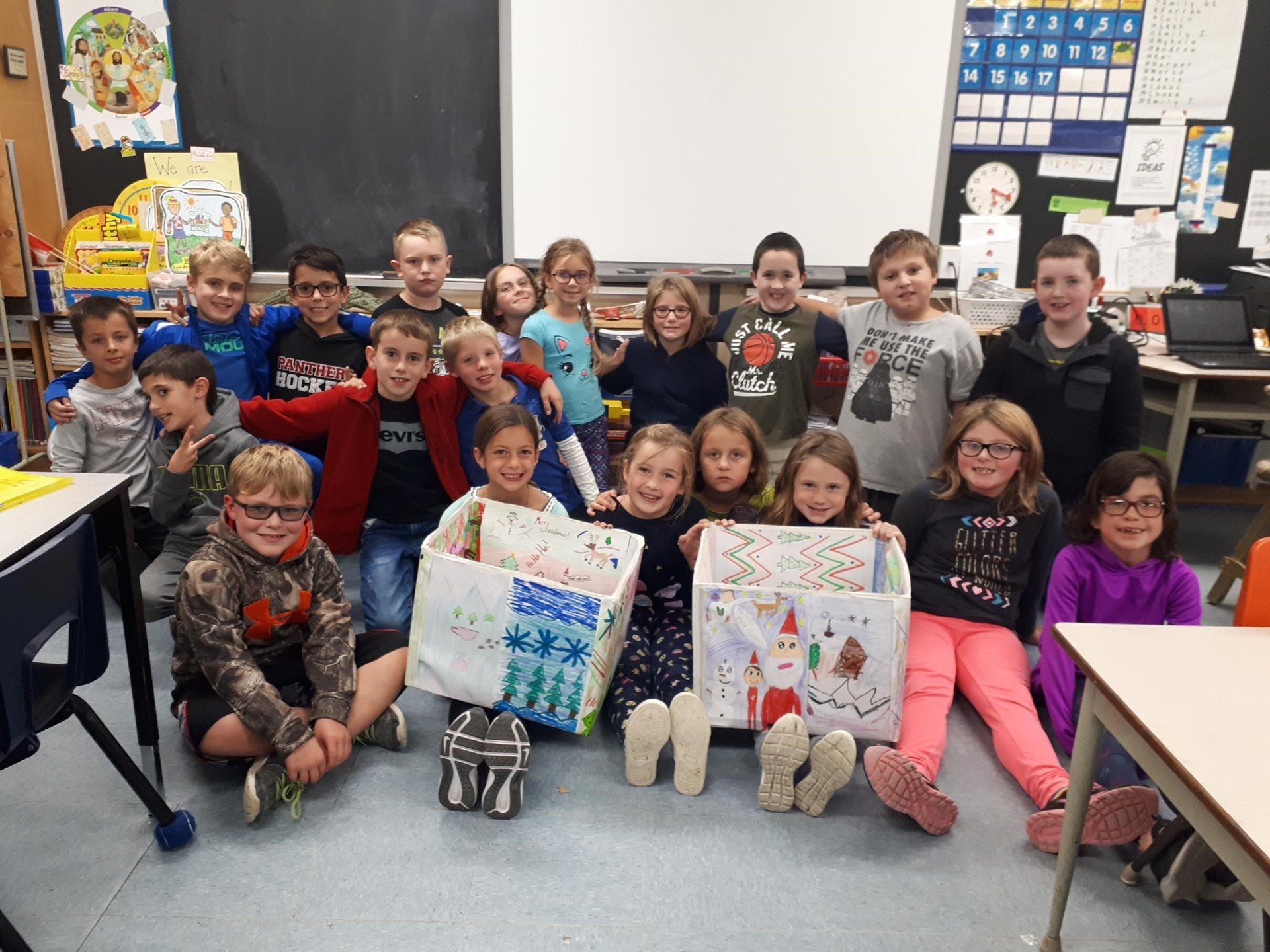 Our Gr. 3's  Support the CWL and our Church Advent Campaign by Decorating Collection Boxes
