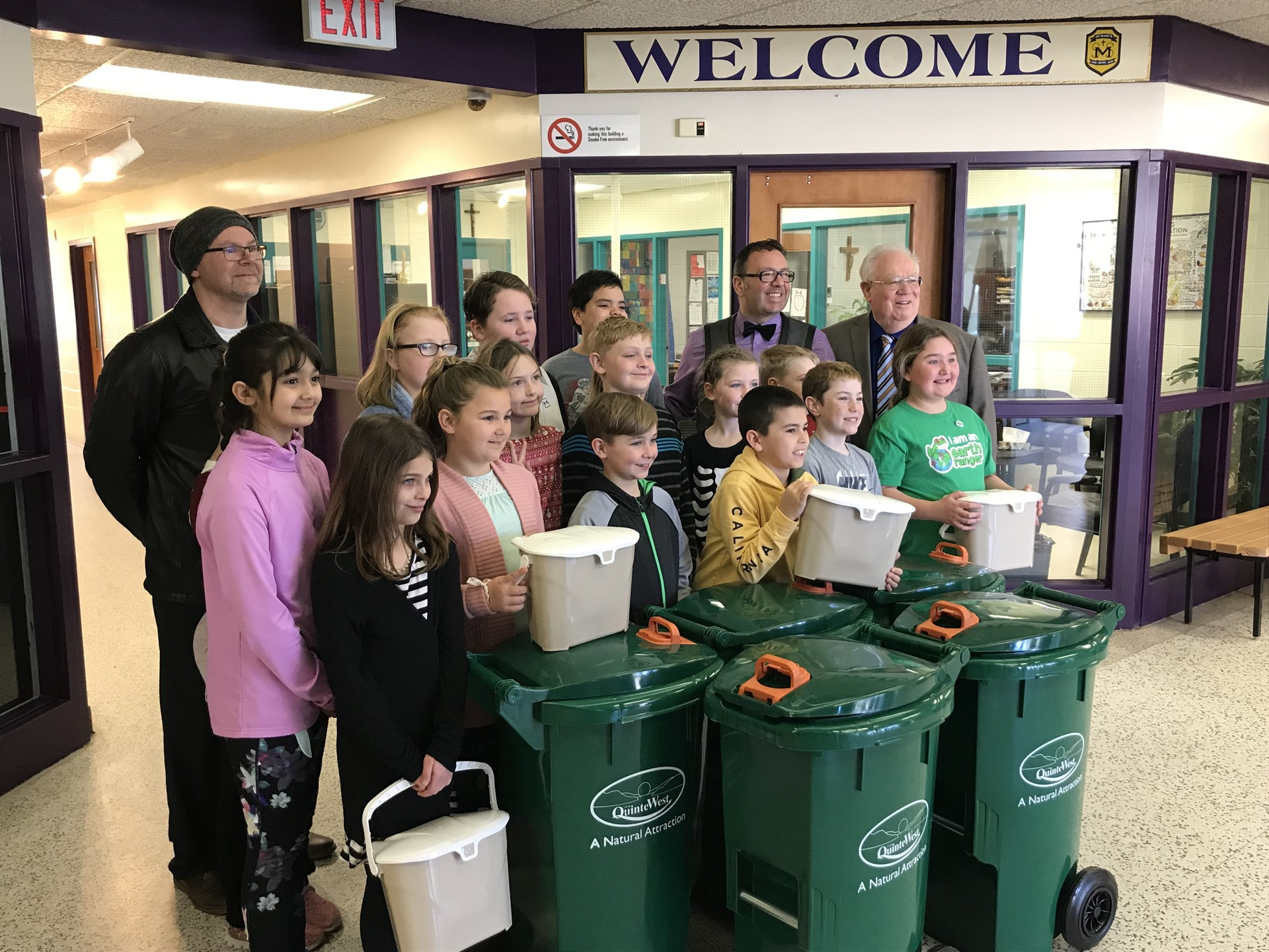 Students recieving green bins from city