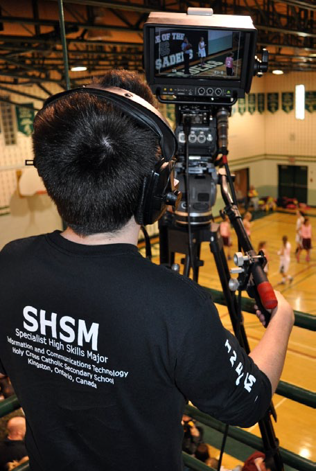 Student filming basketball game