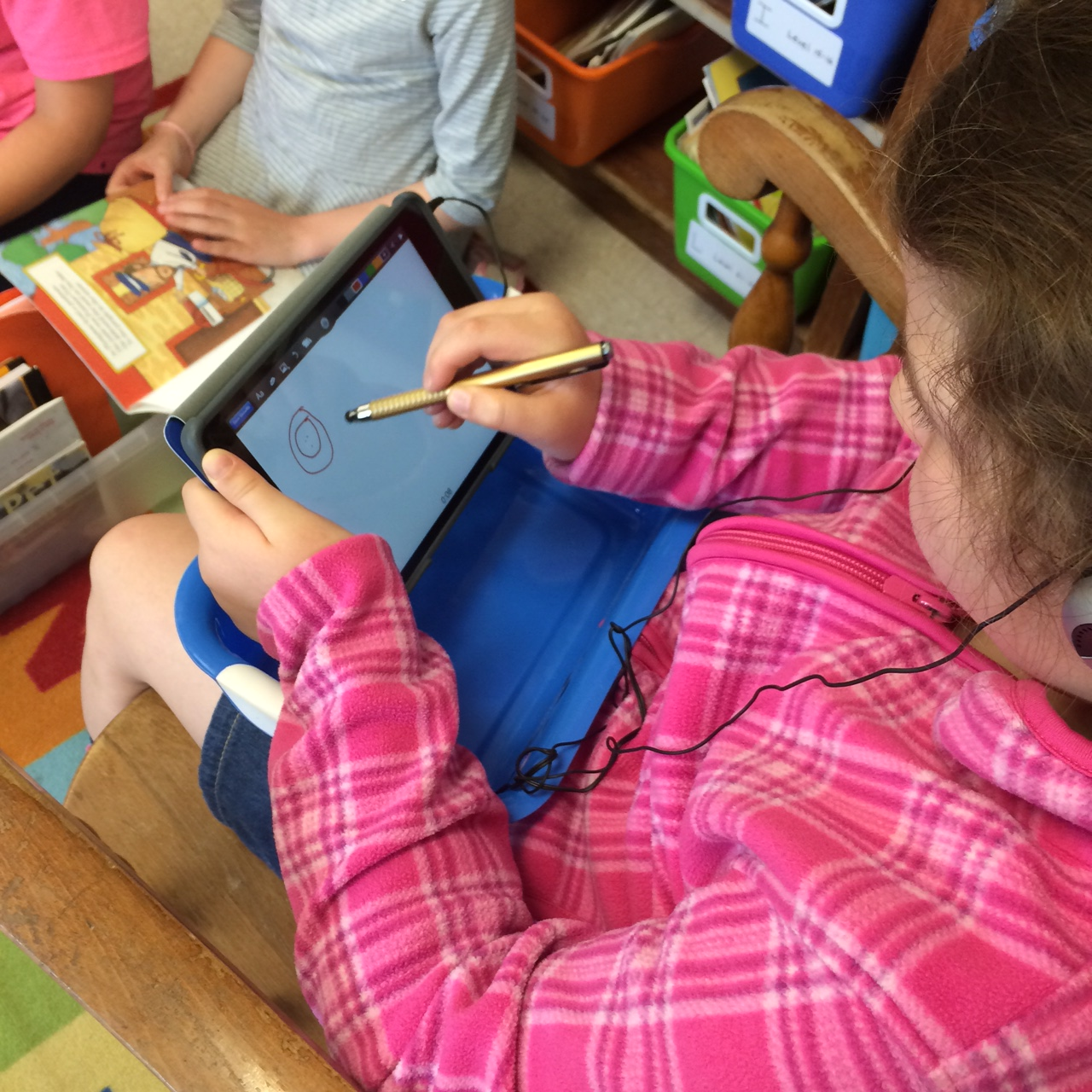 Students using iPads.