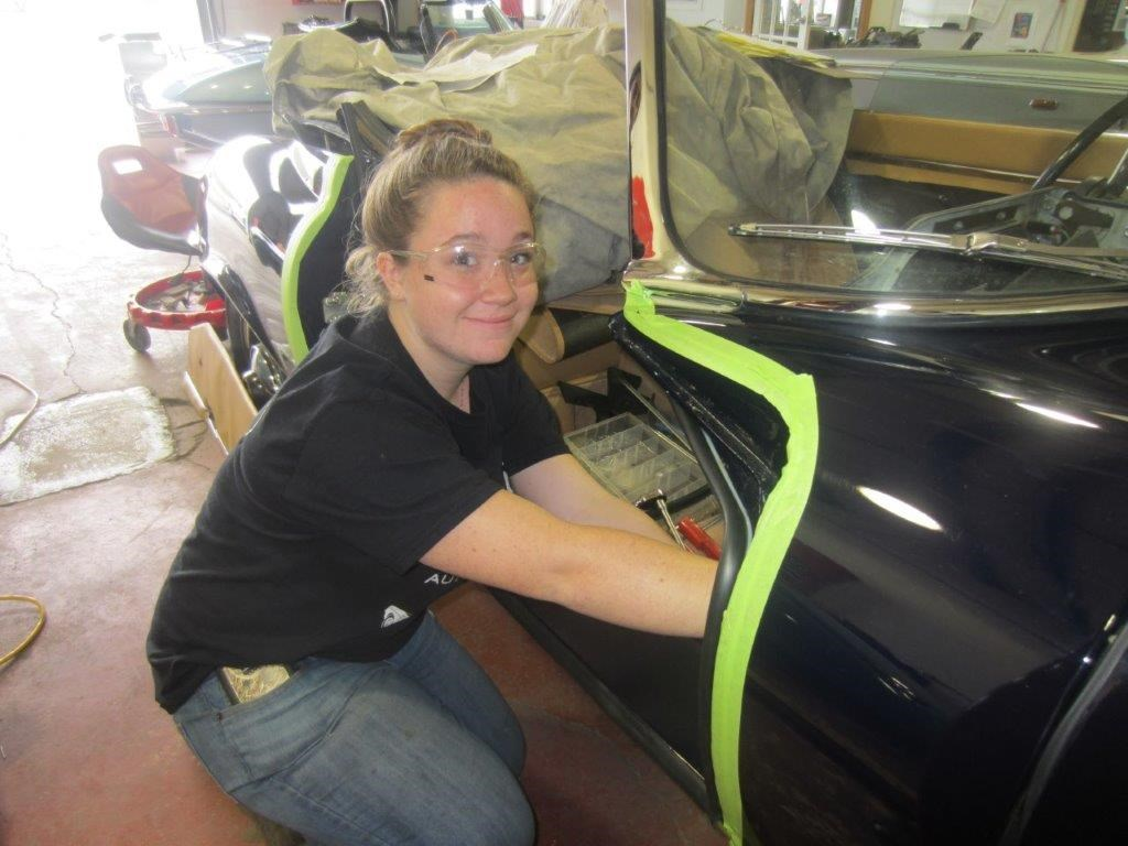 Female student working on car