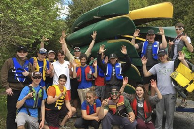 Enviro group with canoes.jpg