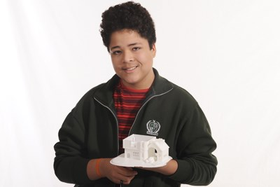 Computer student shows off their 3D print of a house.jpg