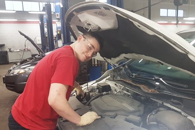 Coop student at automotive work placement.jpg