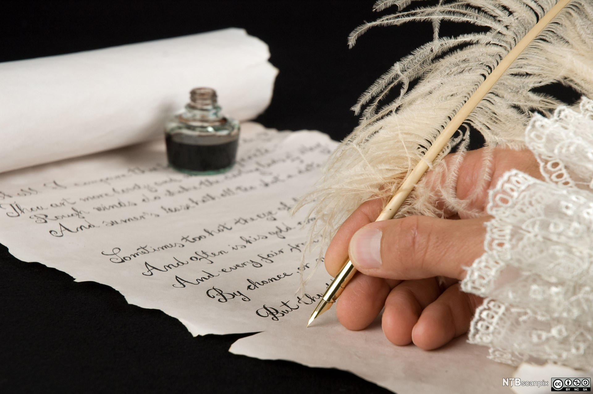 Hand writing poetry with a qull pen