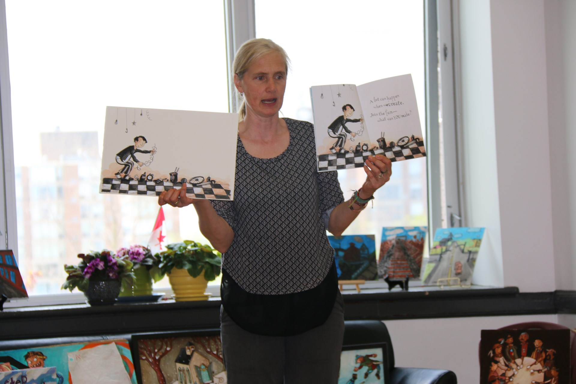 Doretta showing off her books and illustrations