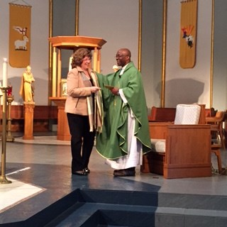 Principal Anne Miller and Father Ben