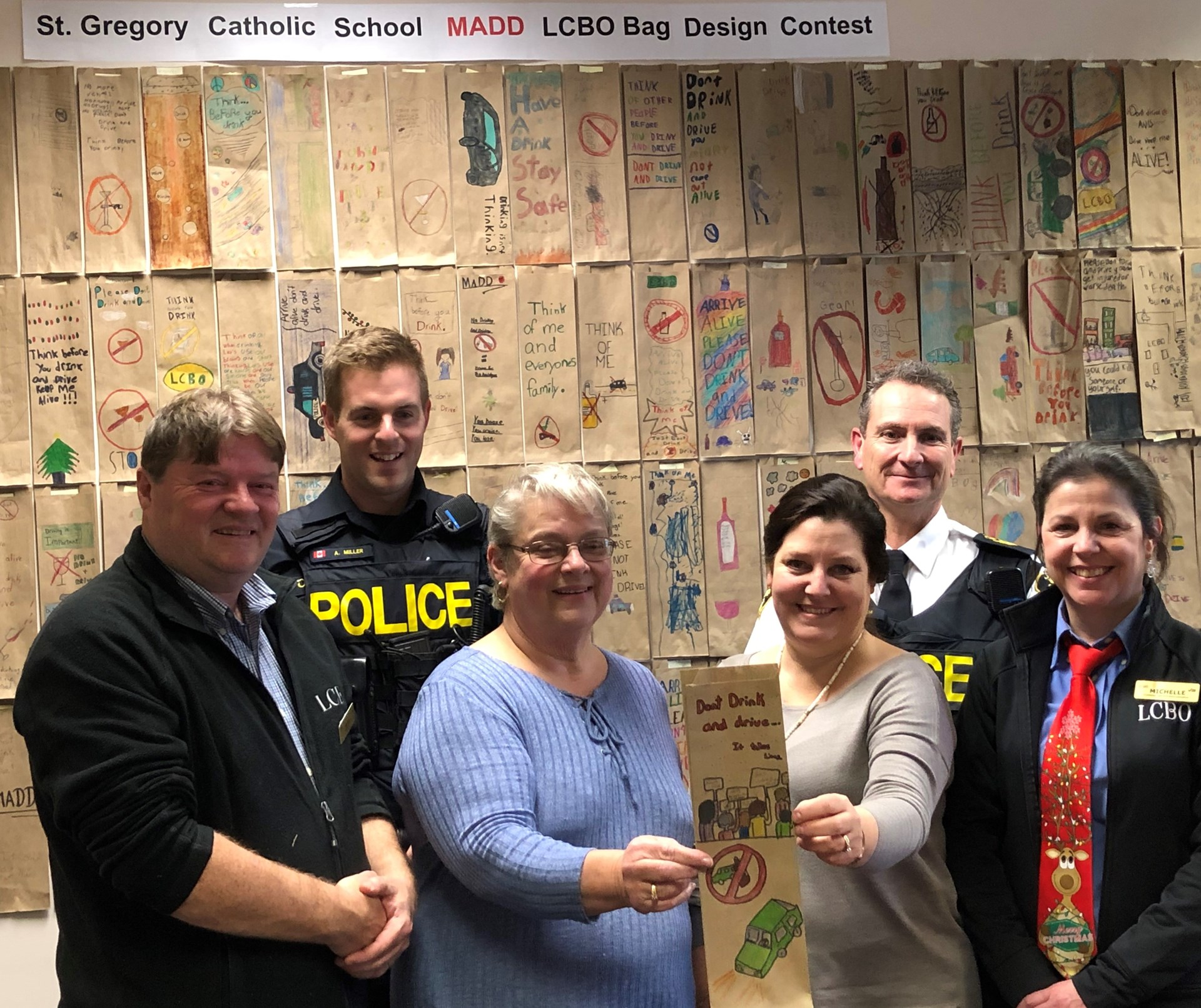 OPP and LCBO and school staff with winning submission