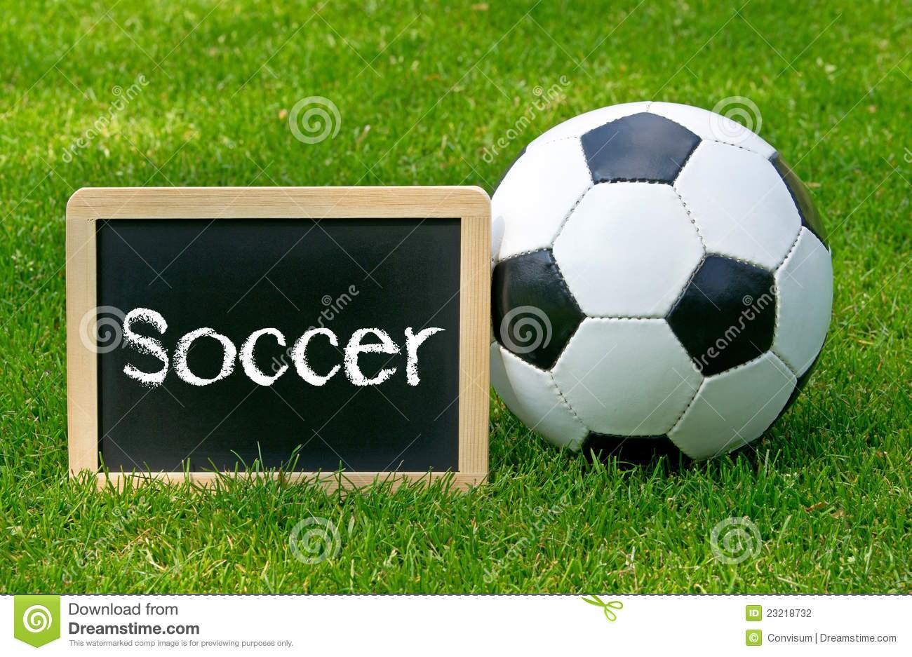 soccer-ball-sign-grass-23218732.jpg